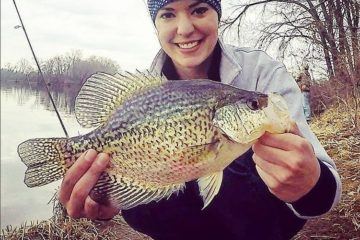Wisconsin girl holds big crappie.